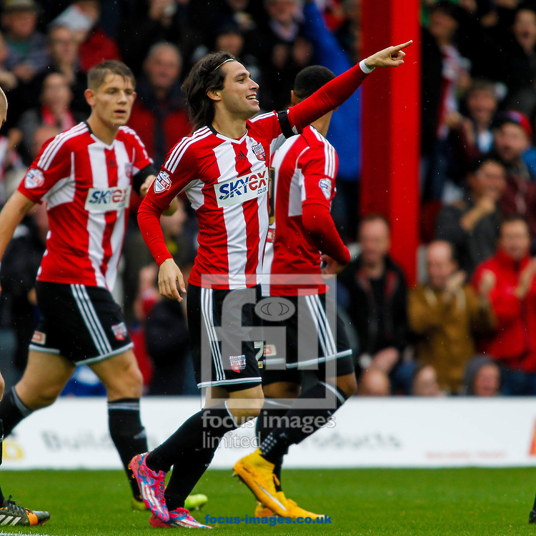 Jota of Brentford celebrates scoring during the Sky Bet Championship match between Brentford and Reading at Griffin Park, London<br /> Picture by Mark D Fuller/Focus Images Ltd +44 7774 216216<br /> 04/10/2014