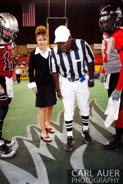Alaska Governor Sarah Palin participates in a coin toss prior to a Alaska Wild Football game in Anchorage, AK