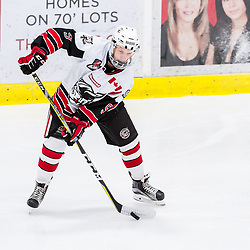 GEORGETOWN, ON - JANUARY 23: Jordan Crocker #9 of the Georgetown Raiders controls the puck during the first period on January 23, 2019 at Gordon Alcott Memorial Arena in Georgetown, Ontario, Canada.<br /> (Photo by Ryan McCullough / OJHL Images)