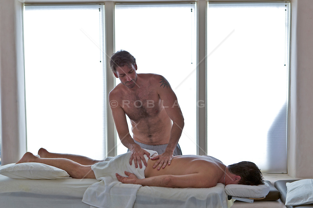 man giving a massage to another man
