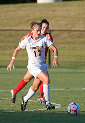 Virginia Cavaliers midfielder/forward Sinead Farrelly (17) dribbles past Liberty Flames midfielder Hope West (18).  The Virginia Cavaliers defeated the Liberty Flames 5-0 in women's soccer at Klockner Stadium on the Grounds of the University of Virginia in Charlottesville, VA on August 29, 2008.