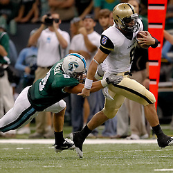 October 9, 2010; New Orleans, LA, USA; Army Black Knights quarterback Trent Steelman (8) breaks a tackle by Tulane Green Wave safety Alex Wacha (8) on a run during the first half at the Louisiana Superdome.  Mandatory Credit: Derick E. Hingle