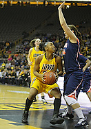 February 24 2011: Iowa Hawkeyes guard Kachine Alexander (21) eyes the basket as Illinois Fighting Illini forward Lana Rukavina (34) defends during the first half of an NCAA women's college basketball game at Carver-Hawkeye Arena in Iowa City, Iowa on February 24, 2011. Iowa defeated Illinois 83-64.