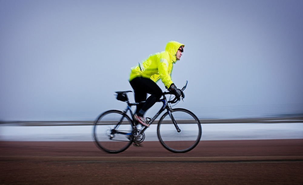 kevin Brady biking in rain and fog South of Vermillion, SD on March 10, 2010..