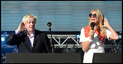 Boris Johnson and Tess Daly  on stage at the Celebration of the 2012 Olympic Games volunteering one year on at the  Queen Elizabeth Olympic Park.<br /> Mayor of London Boris Johnson and Lord Coe will be taking to the stage at Go Local to encourage a new drive in volunteering one year on from the Games. Also present are multi-platinum selling pop rock band McFly; world famous comedian Eddie Izzard, Brit Award nominated The Feeling, and Britain'Got Talent winners Attraction, in addition to stars Jack Carroll and Gabz. The event will be the UKs biggest ever celebration of volunteering and first Olympic and Paralympic legacy event at Queen Elizabeth Olympic Park.<br /> London, United Kingdom<br /> Friday, 19th July 2013<br /> Picture by Andrew Parsons / i-Images