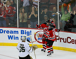 Oct 22, 2008; Newark, NJ, USA; New Jersey Devils center John Madden (11) and New Jersey Devils right wing Brian Gionta (14) celebrate Madden's second goal of the period during the second period of the Devils game against the Dallas Stars at the Prudential Center.