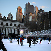Ice skating in Bryant Park, Manhattan, New York as a cold snap hits the eastern seaboard of America. New York, USA. 23rd January 2013. Photo Tim Clayton