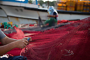Korean fishermen workers repairing fishing net in Pohang harbor / South Korea, Republic of Korea, KOR, 04 October 2009. October 2009: