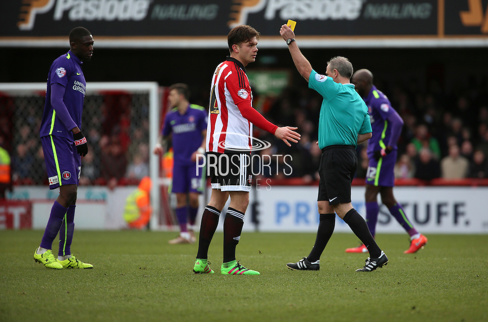 Charlton Athletic striker, Yaya Sanogo (25) yellow card during the Sky Bet Championship match between Brentford and Charlton Athletic at Griffin Park, London, England on 5 March 2016. Photo by Matthew Redman.