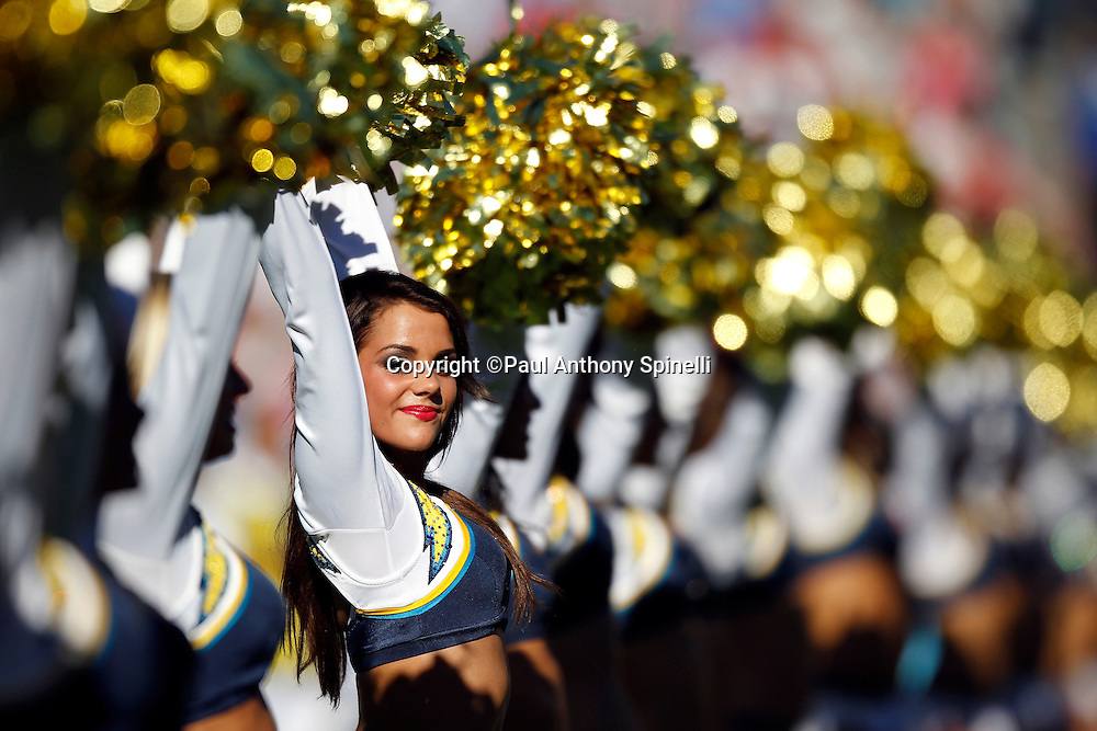 The San Diego Chargers cheerleaders line up and wave pom poms during the NFL week 14 football game against the Kansas City Chiefs on Sunday, December 12, 2010 in San Diego, California. The Chargers won the game 31-0. (©Paul Anthony Spinelli)