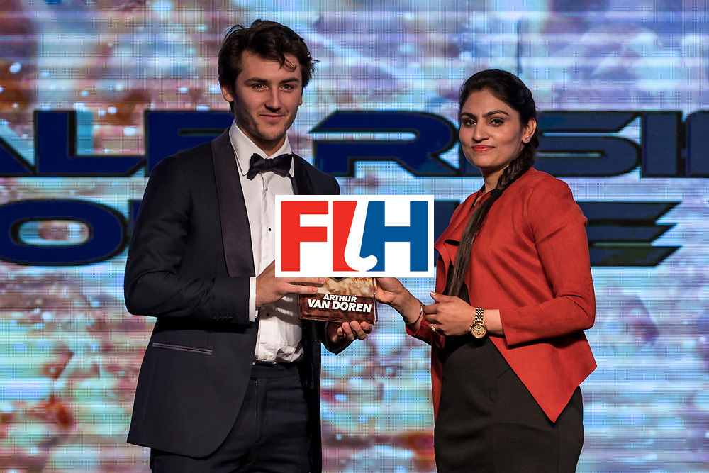 CHANDIGARH, INDIA - FEBRUARY 23: Joydeep Kaur [R], Hockey India Athlete Representative in the EB presents the FIH Male Rising Star of the Year award to Arthur Van Doren [L] of Belgium during the FIH Hockey Stars Awards 2016 at Lalit Hotel on February 23, 2017 in Chandigarh, India. (Photo by Ali Bharmal/Getty Images for FIH)