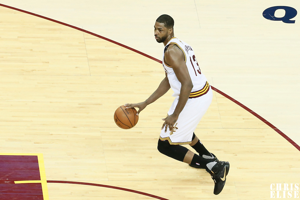 10 June 2016: Cleveland Cavaliers center Tristan Thompson (13) dribbles during the Golden State Warriors 108-97 victory over the Cleveland Cavaliers, during Game Four of the 2016 NBA Finals at the Quicken Loans Arena, Cleveland, Ohio, USA.