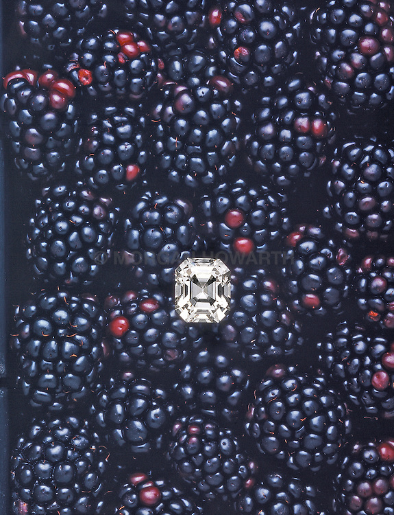 20 karat diamond on a bed of blackberries