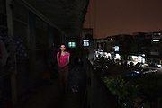 Vietnamese refugee Nguyen, 21, from Con Dau, pictured at her apartment block in Bangkok, Thailand.<br /> <br /> &quot;Because I'm living in a Catholic parish in Con Dau, Da Nang, the Da Nang government wanted to close the parish and take the land away from the people. On May 4th, 2010, there was a funeral of Mrs Dang Thitan, a local woman from the village. The government had refused to allow the funeral to take place so when we brought her coffin to the cemetery the police appeared and they prevented us from entering the cemetery. At that time the people sat around and read the bible but then police reinforcements arrived and started beating the people. The severely attacked the villagers, even pregnant women, they had batons and electric rods. They arrested around 60 people from the parish included my mother, at the end they took away the coffin and left the village in chaos. <br /> <br /> After that all the villagers ran away, some to other parts of Vietnam. The government thought anyone who fled outside were enemies of the country. I went to Laos without any notification to police. I was among the people who threw the muck at the police, they took video so they had my name. Because people resisted the government labelled our village as against them. They wanted to close down the whole village and take away the church and the cemetery. For a long time they don't like the Catholic parish because we had very strong religious belief. In history our village supported the southern government and that's why they don't like these Catholic villages. If you are Catholic you can't work for the government, you have to give up your religion first. We are discriminated against, our village was always overlooked by government.<br /> <br /> My mum was held for 6 months, then sentenced her to home arrest for 9 months, now she has a heart problem because of what happened to her. They thought she was the one who incited violence and they beat her in prison. They follow her now everyday. The other prisoners were badly beat