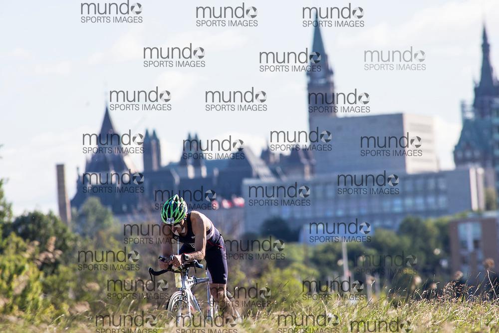 (Ottawa, Canada---10 August 2013)  Mike Puritz (650)  of United States (USA) competing in the 60-64 Male AG International Triathlon Union 2013 World Duathlon Championships (10 km run- 40 km bike- 5km run).
