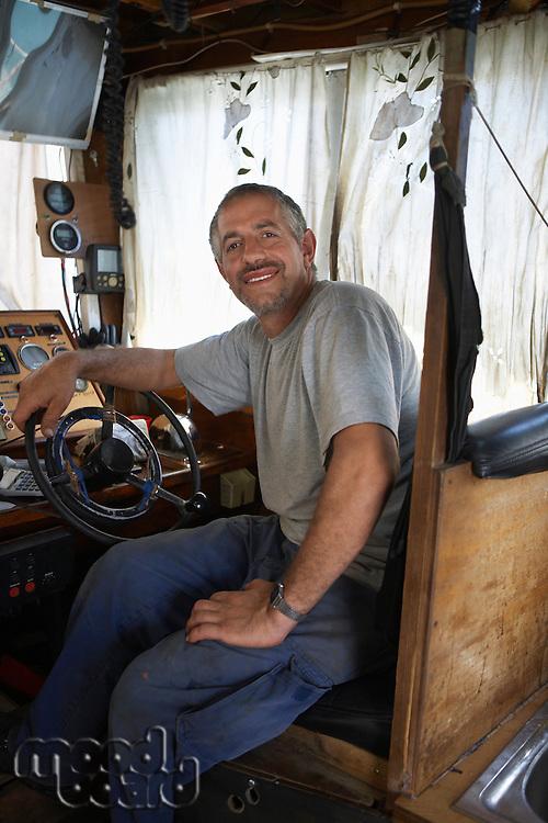 Fisherman in Cabin of Fishing Boat