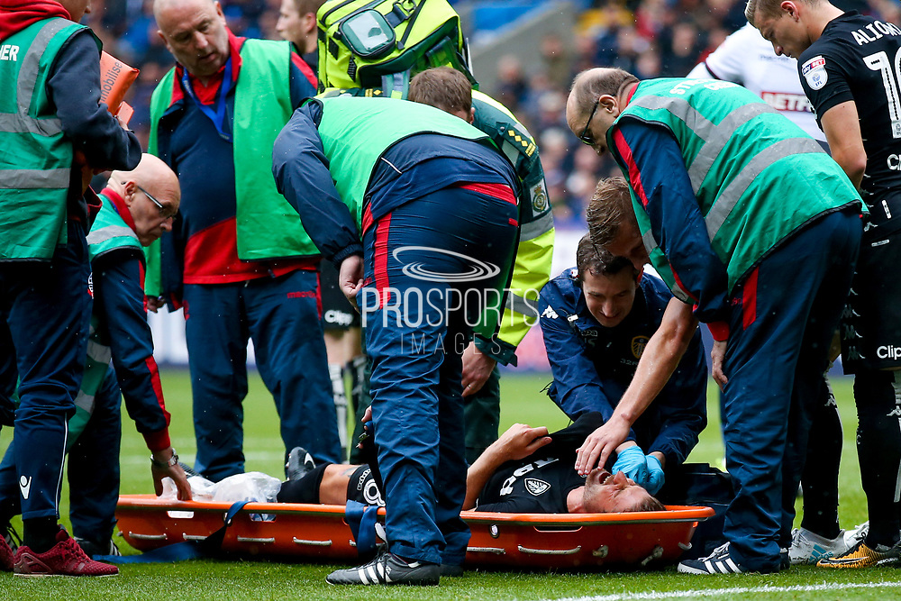 Leeds United defender Gaetano Berardi (28)  is stretchered off in agony during the EFL Sky Bet Championship match between Bolton Wanderers and Leeds United at the Macron Stadium, Bolton, England on 6 August 2017. Photo by Simon Davies.