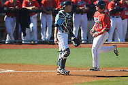 Ole Miss' Austin Anderson (8) scores vs. Rhode Island at Oxford-University Stadium in Oxford, Miss. on Sunday, February 24, 2013. Ole Miss won 5-3 to improve to 7-0.