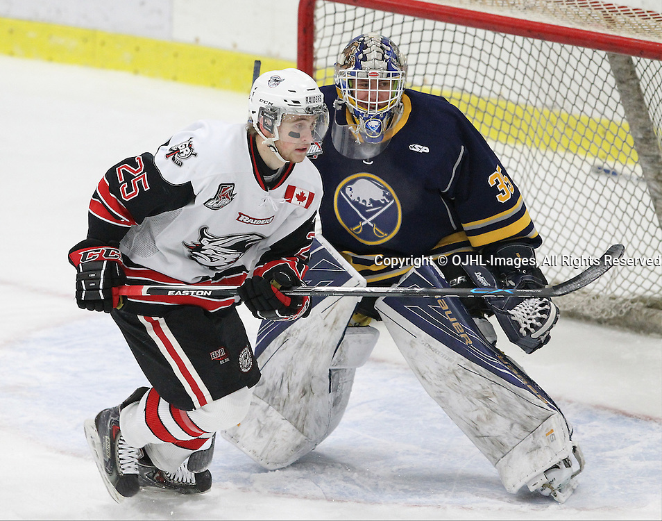 GEORGETOWN, ON  - MAR 2,  2017: Ontario Junior Hockey League, playoff game between the Georgetown Raiders and the Buffalo Jr Sabres. Jordan Anderson #25 of the Georgetown Raiders pursues the play in the crease watched by Alex Camarre #35 during the first period.<br /> (Photo by Tim Bates / OJHL Images)