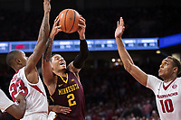 FAYETTEVILLE, AR - DECEMBER 9:  Nate Mason #2 of the Minnesota Golden Gophers drives to the basket against Daniel Gafford #10 and C.J. Jones #23 of the Arkansas Razorbacks at Bud Walton Arena on December 9, 2017 in Fayetteville, Arkansas.  The Razorbacks defeated the Golden Gophers 95-79.  (Photo by Wesley Hitt/Getty Images) *** Local Caption *** Nate Mason; C.J. Jones; Daniel Gafford