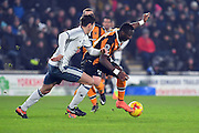 Hull City Striker Adama Diomande (20) and Manchester United player Matteo Darmian (36)  during the EFL Cup semi final match 2 between Hull City and Manchester United at the KCOM Stadium, Kingston upon Hull, England on 26 January 2017. Photo by Ian Lyall.