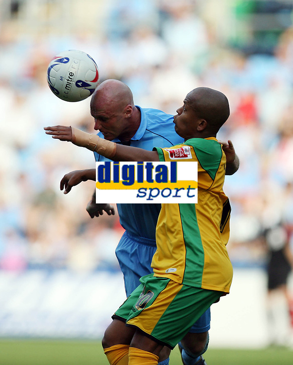 Photo: Rich Eaton.<br /> <br /> Coventry City v Norwich City. Coca Cola Championship. 09/09/2006. Robert Earnshaw right of Norwich is beaten to the ball by Robert Page of Coventry