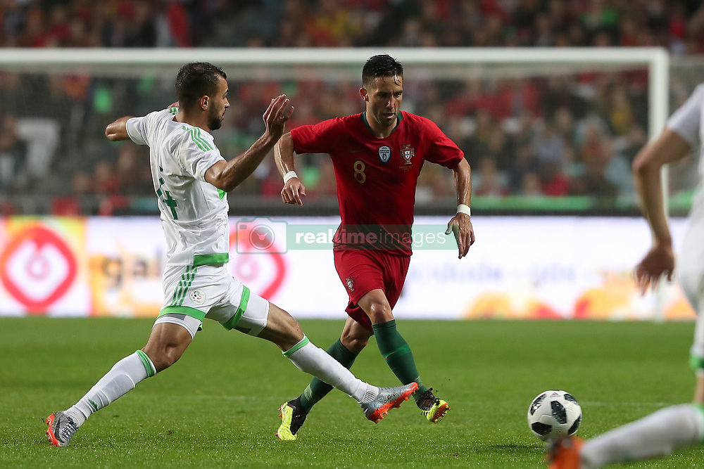 June 7, 2018 - Lisbon, Portugal - Portugal's midfielder Joao Moutinho (R ) vies with Algerias defender Salim Boukhanchouche during the FIFA World Cup Russia 2018 preparation football match Portugal vs Algeria, at the Luz stadium in Lisbon, Portugal, on June 7, 2018. (Portugal won 3-0) (Credit Image: © Pedro Fiuza/NurPhoto via ZUMA Press)