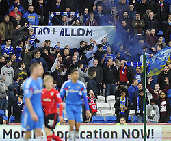 """Cardiff fans protest and hold up a banner reading """"Tan + Allom : Your lousy ideas are not welcome in football""""  - Photo mandatory by-line: Joe Meredith/JMP - Tel: Mobile: 07966 386802 22/02/2014 - SPORT - FOOTBALL - Cardiff - Cardiff City Stadium - Cardiff City v Hull City - Barclays Premier League"""