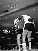 Nash vs Leon Championship Fight.    (N55)..1980..14.12.1980..12.14.1980..14th December 1980..At the Burlington Hotel, Dublin, Charlie Nash defended his European Lightweight Title when he took on Spain's Francesco Leon. .Image shows Leon draped over Nash as Nash tries to throw a body punch.
