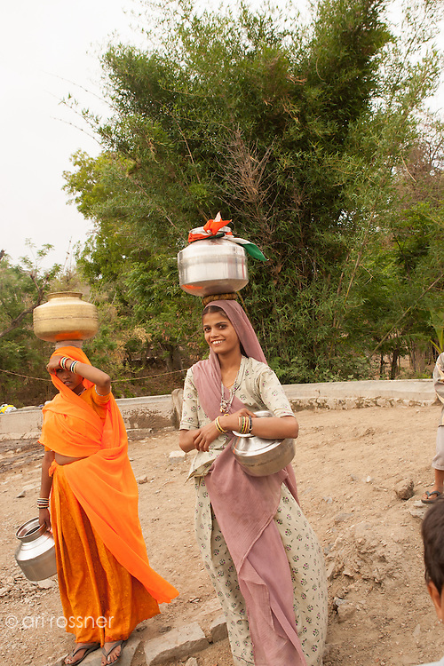 Women carrying water from the well on their heads