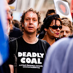 London, UK - 15 June 2012: a man wears a t-shirt reading 'Deadly Coal' during the Carnival of Dirt. More than 30 activist groups from London and around the world have come together to highlight the illicit deeds of mining and extraction companies.
