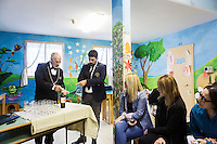 LECCE, ITALY - 10 NOVEMBER 2016: (L-R) Roberto Giannone and Marco Albanese, two trained sommeliers, volunteer to lecture female inmates on the arts and crafts of wine tasting and serving, in the largest penitentiary in the southern Italian region of Apulia, holding 1,004 inmates in the outskirts of Lecce, Italy, on November 10th 2016.<br /> <br /> Here a group of ten high-security female inmates and aspiring sommeliers , some of which are married to mafia mobsters or have been convicted for criminal association (crimes carrying up to to decades of jail time), are taking a course of eight lessons to learn how to taste, choose and serve local wines.<br /> <br /> The classes are part of a wide-ranging educational program to teach inmates new professional skills, as well as help them develop a bond with the region they live in.<br /> <br /> Since the 1970s, Italian norms have been providing for reeducation and a personalized approach to detention. However, the lack of funds to rehabilitate inmates, alongside the chronic overcrowding of Italian prisons, have created a reality of thousands of incarcerated men and women with little to do all day long. Especially those with a serious criminal record, experts said, need dedicated therapy and professionals who can help them.