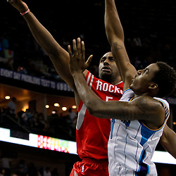 April 19, 2012; New Orleans, LA, USA; Houston Rockets shooting guard Courtney Lee (5) shoots over New Orleans Hornets small forward Al-Farouq Aminu (0) during the second half at the New Orleans Arena. The Hornets defeated the Rockets 105-99.   Mandatory Credit: Derick E. Hingle-US PRESSWIRE