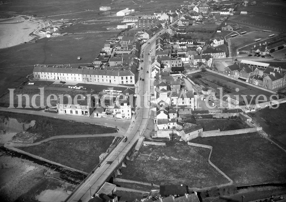 A76(A) Blessington.   02/01/63 (Part of the Independent Newspapers Ireland/NLI collection.)<br /> <br /> <br /> These aerial views of Ireland from the Morgan Collection were taken during the mid-1950's, comprising medium and low altitude black-and-white birds-eye views of places and events, many of which were commissioned by clients. From 1951 to 1958 a different aerial picture was published each Friday in the Irish Independent in a series called, 'Views from the Air'.<br /> The photographer was Alexander 'Monkey' Campbell Morgan (1919-1958). Born in London and part of the Royal Artillery Air Corps, on leaving the army he started Aerophotos in Ireland. He was killed when, on business, his plane crashed flying from Shannon.