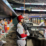NEW YORK, NEW YORK - July 27: Greg Garcia #35 of the St. Louis Cardinals in the dugout preparing to bat during the St. Louis Cardinals Vs New York Mets regular season MLB game at Citi Field on July 27, 2016 in New York City. (Photo by Tim Clayton/Corbis via Getty Images)
