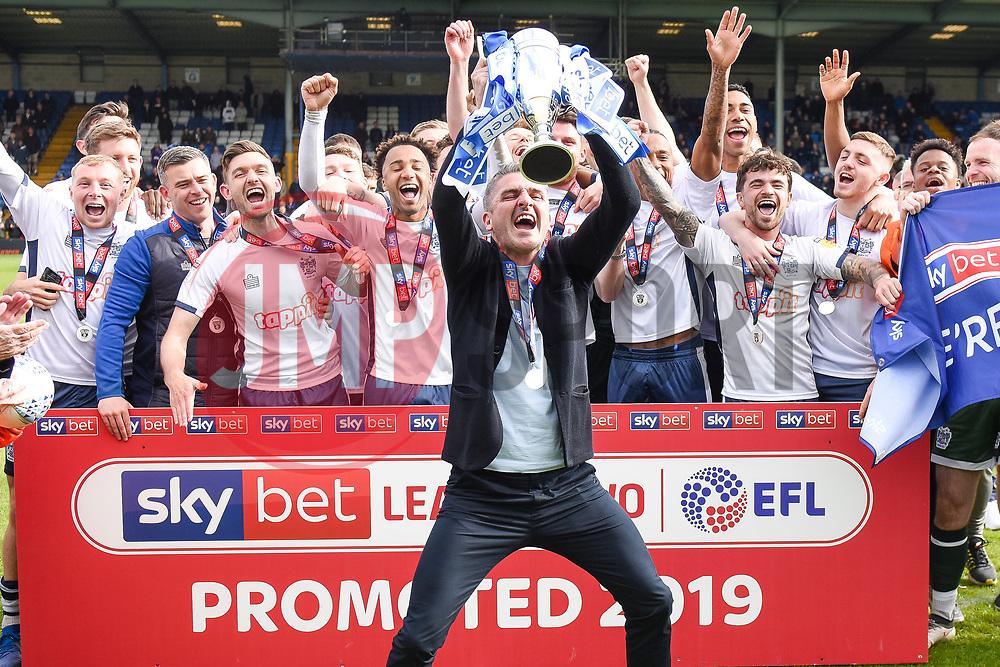 Bury manager Ryan Lowe lifts the trophy as Bury celebrate promotion - Mandatory by-line: JMP - 04/05/2019 - FOOTBALL - Gigg Lane - Bury, England - Bury v Port Vale - Sky Bet League Two