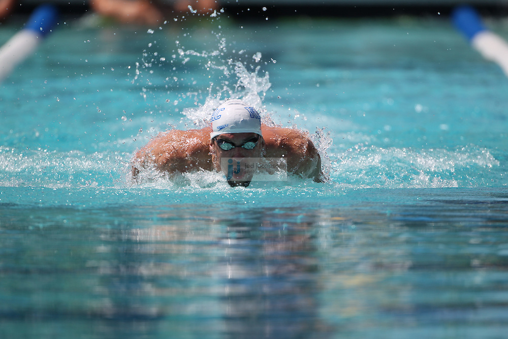 SANTA CLARA, CA - JUNE 17:  Michael Phelps competes in the 100m butterfly during day 2 of the Santa Clara International Grand Prix at George F. Haines International Swim Center on June 17, 2011 in Santa Clara, California.  (Photo by Jed Jacobsohn)