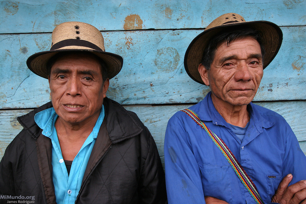 Ixil Mayan men await to receive the remains of family members killed during the Guatemalan internal armed conflict in the early 1980s. The National Coordination for Guatemalan Widows (CONAVIGUA) and the Forensic Anthropological Foundation of Guatemala (FAFG) returned the remains of 14 wartime victims to their respective family members in the hamlet of Xaxmoxan, Chajul, up in the Ixil Mayan highlands of Quiché after successful exhumations of clandestine mass graves. Most of the victims perished in the mountainside between 1980 and 1983 as they fled the Army's brutal Scorched Earth campaign against a civil population accused of supporting the guerrilla groups in the region. Xaxmoxan, Chajul, Quiché, Guatemala. January 25, 2007.