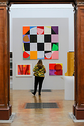 &copy; Licensed to London News Pictures. 08/06/2017. London, UK. A visitor views (top) &quot;Part-Song&quot; by Mali Morris RA (GBO17,500).  Preview of the Summer Exhibition 2017 at the Royal Academy of Arts in Piccadilly.  Co-ordinated by Royal Academician Eileen Cooper, the 249th Summer Exhibition is the world's largest open submission exhibition with around 1,100 works on display by high profile and up and coming artists.<br />  Photo credit : Stephen Chung/LNP