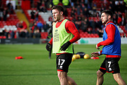 Lincoln City Shay McCartan(17) warming up before the EFL Sky Bet League 2 match between Lincoln City and Mansfield Town at Sincil Bank, Lincoln, United Kingdom on 24 November 2018.