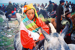 China, Xiahe, 2005. Tibetan nomads gather every year for a ceremony and horse race on the high altitude plain near Sanke Pass.