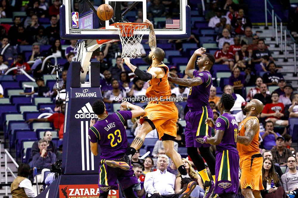 Feb 6, 2017; New Orleans, LA, USA; Phoenix Suns center Tyson Chandler (4) misses a dunk as New Orleans Pelicans forward Terrence Jones (9) and forward Anthony Davis (23) defend during the second quarter of a game at the Smoothie King Center. Mandatory Credit: Derick E. Hingle-USA TODAY Sports