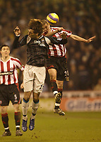 Photo: Aidan Ellis.<br /> Sheffield United v Manchester City. The Barclays Premiership. 26/12/2006.<br /> sheffield's Chris Armstrong beats City's Bernardo Corradi to the ball
