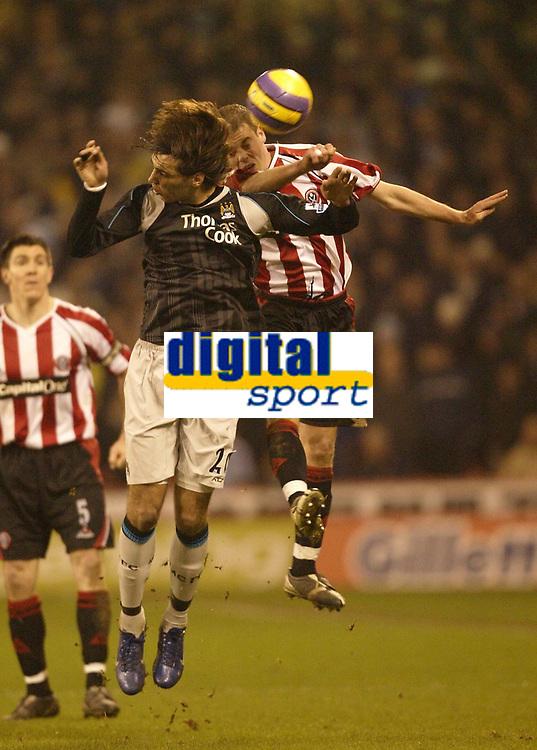 Photo: Aidan Ellis.<br /> Sheffield United v Manchester City. The Barclays Premiership. 26/12/2006.<br /> sheffield's Chris Armstrong beats City's Bernardo Corradi to the ball