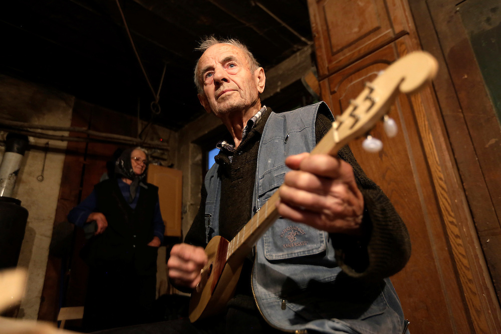 Ivan Buric playing 'dangubica', a traditional instrument of Kuterevo village, Croatia.  An 87-year old Ivan makes 'dangubica' instruments and other wood handicrafts since his retirement.