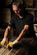 Repairing old casks, Glenfiddich Distillery, Scotland
