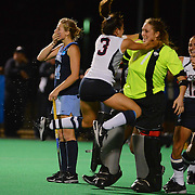 UNC forward Emma Bozek (14) reacts after missing an open net penalty shot to prolong the game.
