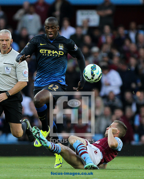 Tom Cleverley (right) of Aston Villa tackles Yaya Tour&eacute; (left) of Manchester City during the Barclays Premier League match at Villa Park, Birmingham<br /> Picture by Tom Smith/Focus Images Ltd 07545141164<br /> 04/10/2014