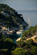 France, Provence, Sailboats in Calanque near town of Cassis.