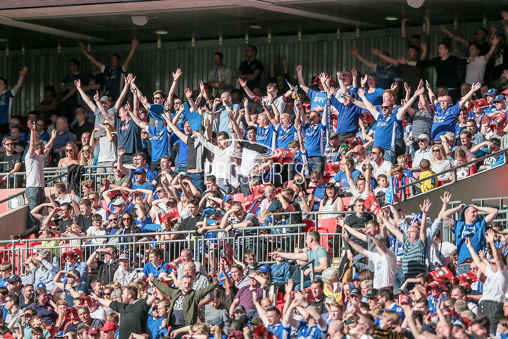 Macclesfield fans sing in the sunshine during the FA Trophy match between Macclesfield Town and York City at Wembley Stadium, London, England on 21 May 2017. Photo by Mark P Doherty.